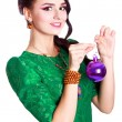 Beautiful young woman with a Christmas bauble — Stock Photo #60279443
