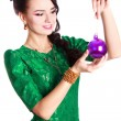 Beautiful young woman with a Christmas bauble — Stock Photo #60279769