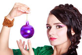 Beautiful young woman with a Christmas bauble — Stock Photo
