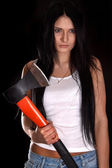 Young woman with a big axe — Stockfoto