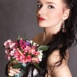 Portrait of a young beautiful fiancee with a bunch of pink flowe — Stock Photo #61106341