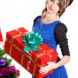 Portrait of a beautiful young woman holding a present near the C — Stock Photo #64403657