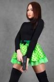 Portrait of a young attractive woman in a bright green skirt wit — Stock Photo