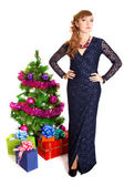 Portrait of a beautiful young woman near the Christmas tree and  — Stock Photo