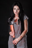Young woman with a big bloody axe — Stock Photo