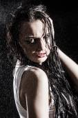Wet sexy woman covered with water drops — Stock Photo
