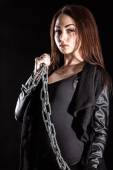 Beautiful young woman with chains — Stock Photo
