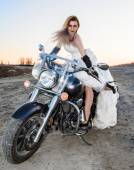Beautiful young bride on a bike — Stock Photo