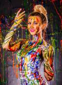 Beautiful young woman covered with paints — Stock Photo