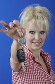 Woman holding car key — Stock Photo