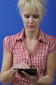 Woman with an e-book reader — Stock Photo