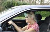 Woman driving a gray car — Stock Photo
