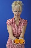 Portrait of womanwith a clementine — Stock Photo