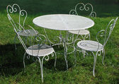 Garden table and chairs in summer — Stock Photo