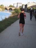Frankrijk, Jogger langs de rivier — Stockfoto