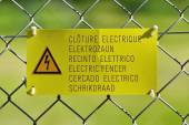 Electric fence sign — Стоковое фото