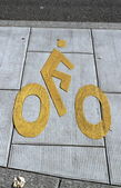Bicycle sign path on the pavement — Stock Photo