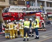 Firemen discussing intervention in Geneva, Switzerland — Stock Photo
