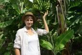 Woman visiting banana plantation — Stock Photo