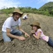 Family of farmers planting seedling — Stock Photo #53973165
