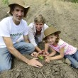 Family of farmers planting seedling — Stock Photo #53975417
