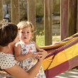 Mother and daughter relaxing in hammock — Stock Photo #53979963