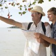 Middle aged couple on vacation with map — Stock Photo #69288791