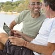 Happy gay couple on a date with tablet — Stock Photo #69288899