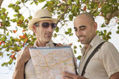 Tourists with map — Stock Photo