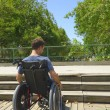 Man in wheelchair in front of stairs — Stock Photo #69294981