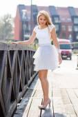 Beautiful model in white skirt — Stock Photo