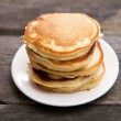 Delicious pancakes on a wooden table — Stock Photo #54476401
