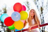 Young beautiful woman with balloons — Stock Photo