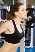 Young slim woman exercising in a gym — Stock Photo