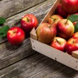 Fresh red apples in a wooden crate — Stock Photo #54928529