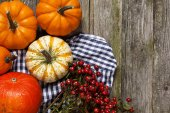 Colorful pumpkins on old wood — Stock Photo