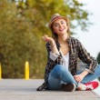 Young beautiful girl sitting on a pier — Stock Photo #57543749