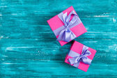 Pink gift boxes on blue wood — Stock Photo