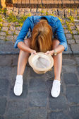 Young woman begging with a hat — Stock Photo