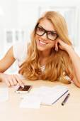 Young woman doing her accounts — Stock Photo
