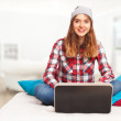 Pretty teenage girl working with a laptop — Stock Photo #63524855