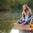 Young beautiful girl sitting on a pier — Stock Photo #63524899