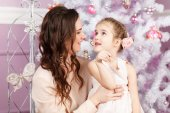 Mother and daughter on Christmas — Stock Photo