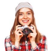 Teenage girl holding a film camera — Stock Photo