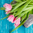 Beautiful pink tulips on blue wood background — Stock Photo #63865721