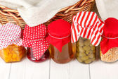Preserves on white wood background — Stock Photo