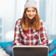 Pretty teenage girl working with a laptop — Stock Photo #65151347