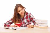 Young girl reading her textbooks — Stock Photo