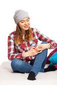 Teenage girl with a smartphone — 图库照片