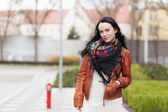 Young stylish woman in a city — Stock Photo